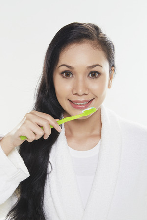 Woman brushing her teeth photo
