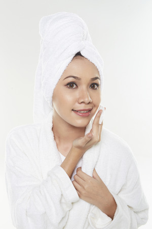 Woman applying facial product photo