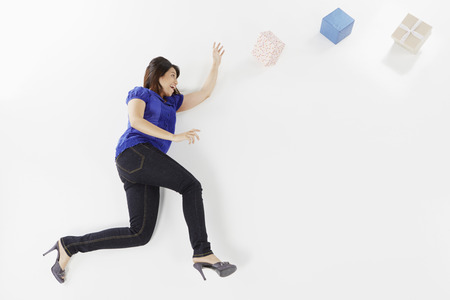 Woman posing on the floor with gift boxes