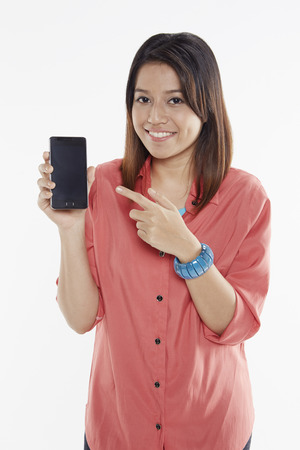 Woman holding up mobile phone photo