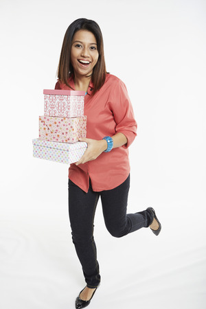 Woman carrying a stack of gift boxes photo
