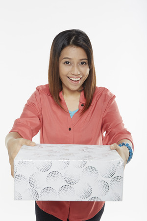Woman holding a gift box photo