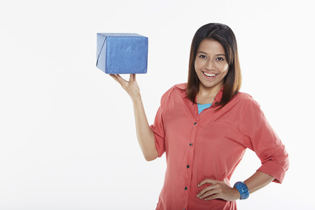 Woman holding a gift box photo