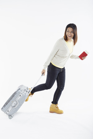 Woman with suitcase and passport