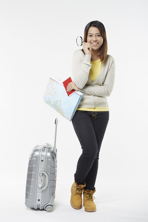 Woman with traveling items photo