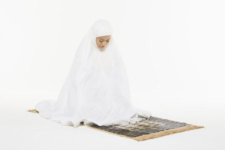 reciting: Woman performing the ending salam Stock Photo