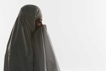 reciting: Woman praying during the end recital of the prayer