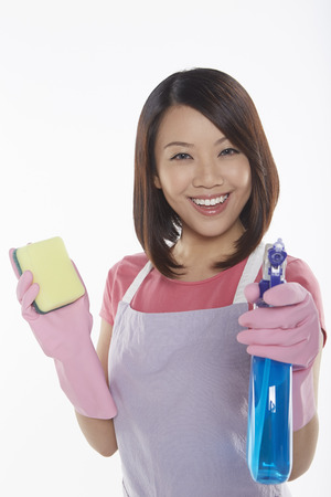 Woman holding a sponge and spray bottle photo