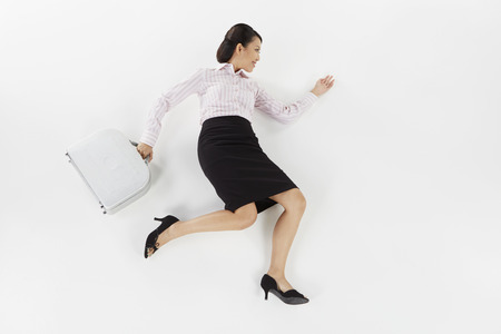 Businesswoman posing on the floor with briefcase photo