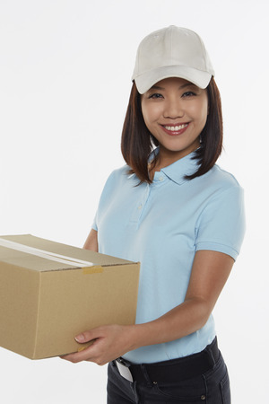 Delivery person carrying a cardboard box photo