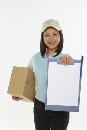 Delivery person holding up a clip file photo