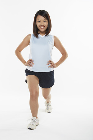 lunges: Woman stretching and doing lunges