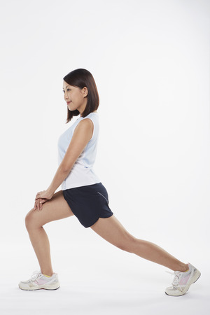 facing right: Woman stretching and doing lunges, facing right