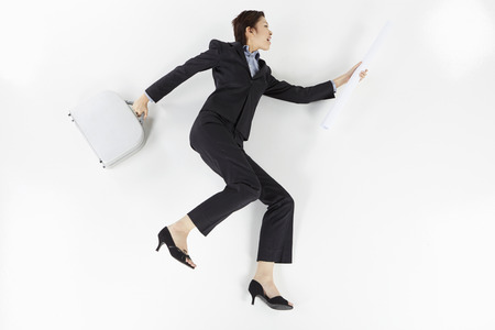 Cheerful businesswoman posing on the floor photo