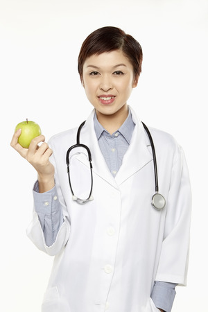 medical personnel: Medical personnel holding a green apple Stock Photo