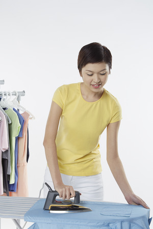 Woman ironing clothes photo