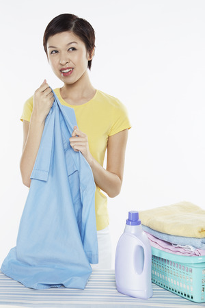 Woman holding a piece of clean laundry photo