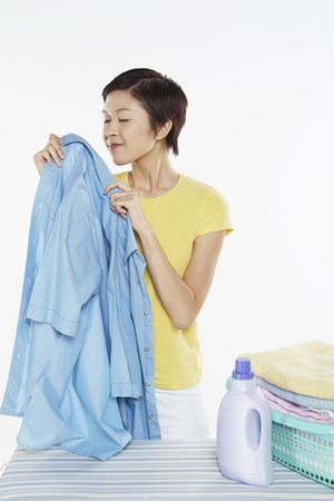 Woman smelling a clean blouse photo