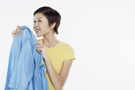fragrant: Woman smelling a clean blouse