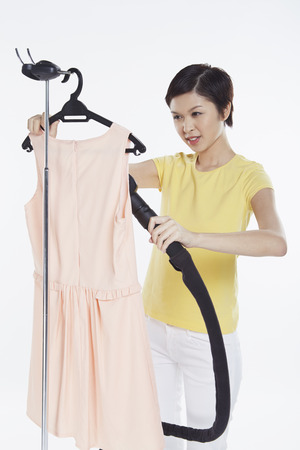 Woman ironing a dress photo