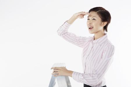 looking ahead: Businesswoman looking ahead