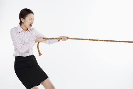 Businesswoman pulling a tightrope photo