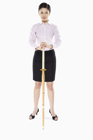 Businesswoman holding a kendo stick photo