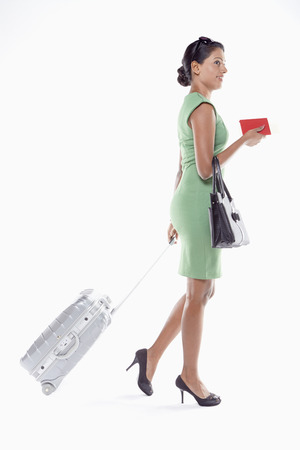 Woman with suitcase and passport photo