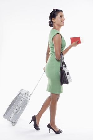 Woman with suitcase and passport Stock Photo - 22995697