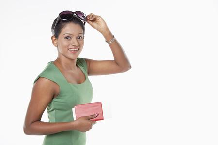 Woman holding her passport photo