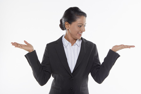 hand gesture: Businesswoman showing hand gesture, facing left Stock Photo