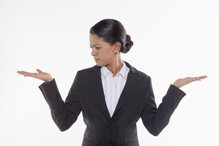 facing right: Businesswoman showing hand gesture, facing right