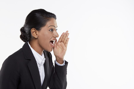 Businesswoman showing a whispering hand gesture photo