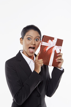 red gift box: Businesswoman holding a red gift box