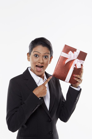 Businesswoman holding a red gift box photo