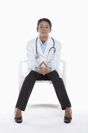 Medical personnel sitting on a chair photo