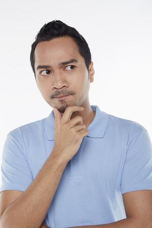 Man contemplating photo