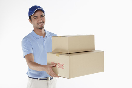 Delivery person handing out cardboard boxes