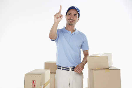 Delivery man showing hand gesture photo