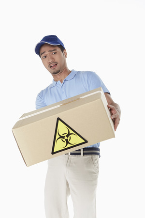 Delivery person carrying a dangerous package Stock Photo - 22996226