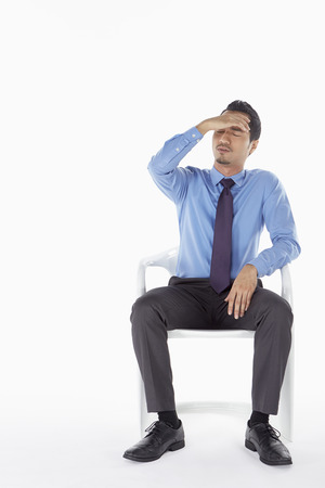 Businessman feeling stressed photo