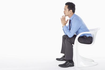 Businessman contemplating photo