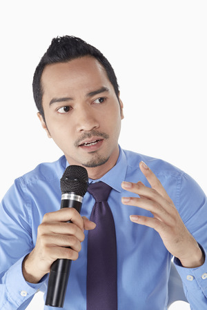 Businessman talking into the microphone photo
