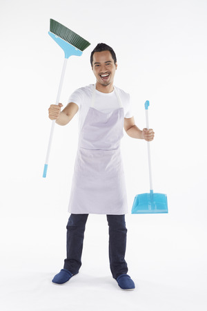 Cheerful man with broom and dustpan photo