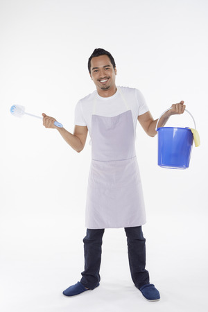Man holding a brush and bucket photo
