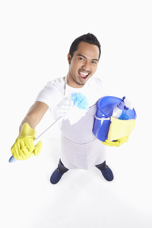 cleaning supplies: Man holding cleaning supplies Stock Photo