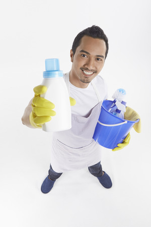cleaning supplies: Man holding a variety of cleaning supplies