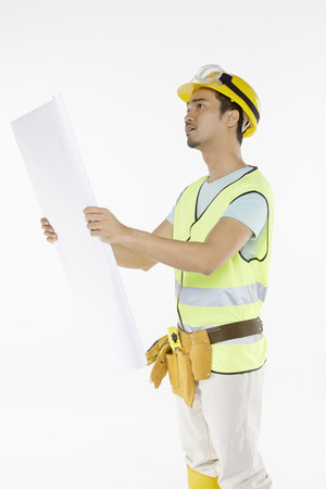Construction worker studying the construction plan photo