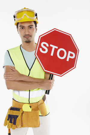 Construction worker holding a Stop' sign' photo