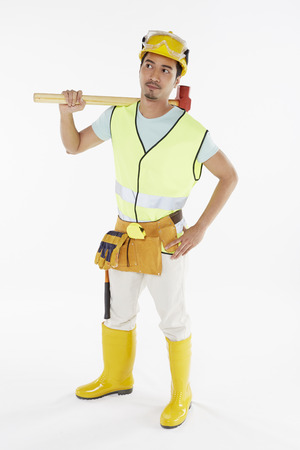 Construction worker holding a hammer photo